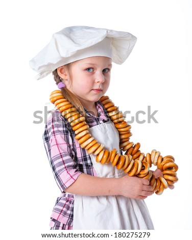 Little Cook With A Bagels In Her Hands. Isolated on white background - stock photo
