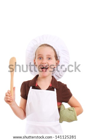 Little cook with a happy smile - stock photo