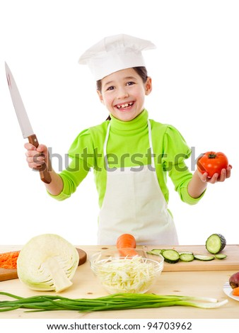 Little cook with knife and tomatoes in hands, isolated on white - stock photo
