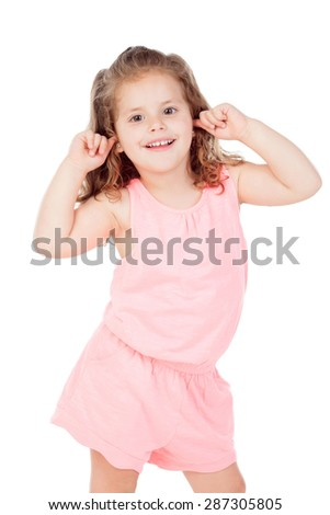 Little cool girl covering her ears with the fingers isolated on a white background - stock photo