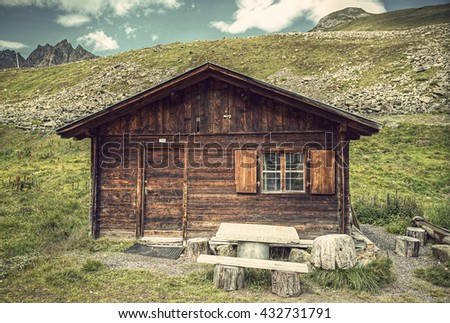 little cottage in the European alps, HDR image, Vintage filtered style