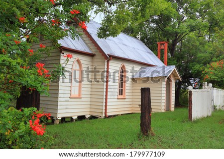 Little country church with outdoor bell, arched windows and portico  St Andrews Built 1927. - stock photo