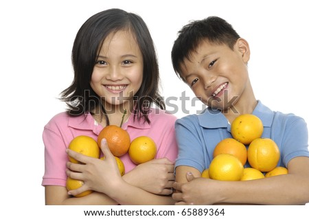 Little couple kids with oranges isolated on white background - stock photo