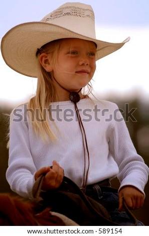 Little Cowgirl on Horseback #1 - stock photo