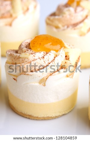 little cream cakes with vanilla, orange and white chocolate flavour