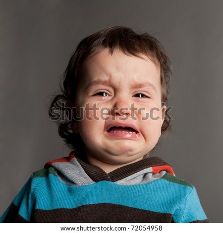 little crying boy portrait - stock photo