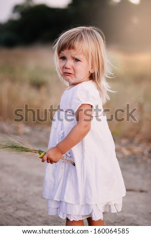 Little crying girl - stock photo