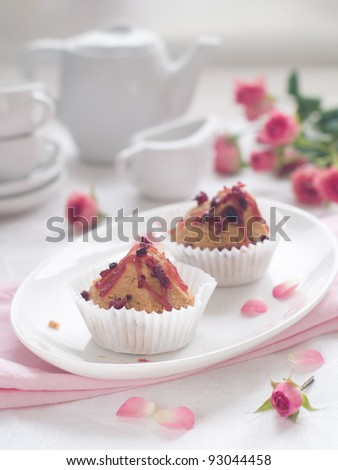 Little cupcakes with coffee cups, selective focus