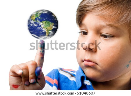Little curious child spinning the planet Earth  on his finger - stock photo