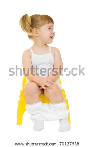 Little curious girl on chamberpot isolated - stock photo