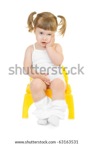 Little curious girl on chamberpot isolated background - stock photo