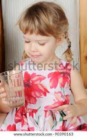 Little Curly Girl Drinking Pure Water