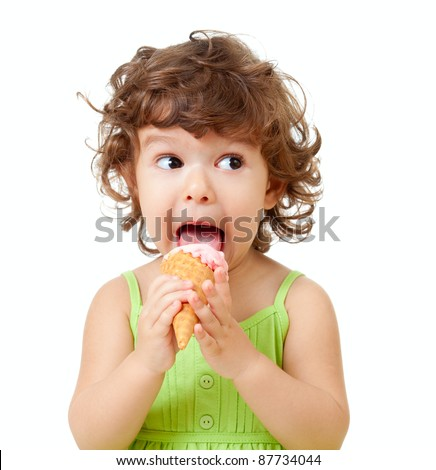 little curly girl with ice cream in studio isolated - stock photo