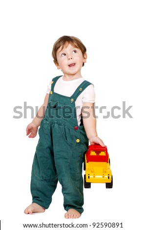 Little cut boy holding a plastic toy truck. Isolated on white - stock photo