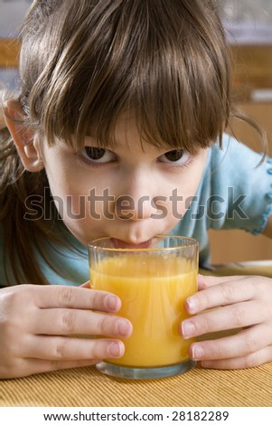little cute adorable serious girl seven years old drink orange juice