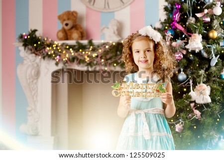 Little cute and smiling Christmas girl - stock photo