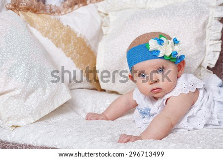 Little cute baby girl lying in the nursery. The concept of carefree childhood.