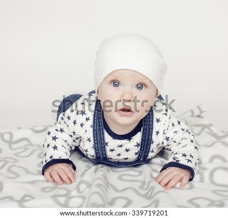 little cute baby toddler on carpet isolated close up moving