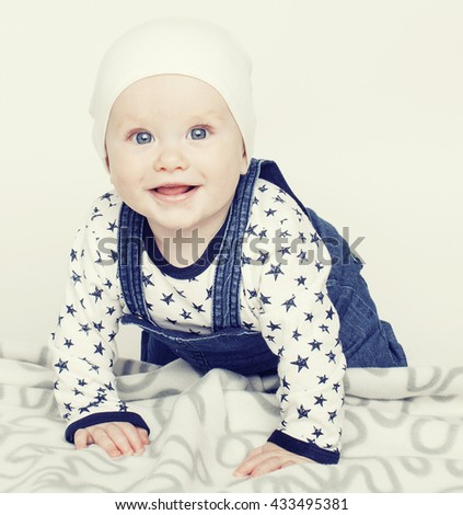 little cute baby toddler on carpet isolated close up smiling adorable - stock photo