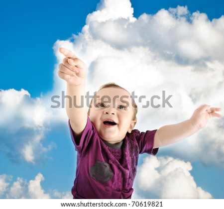 Little cute baby wants to fly into sky, beautiful moment :) - stock photo