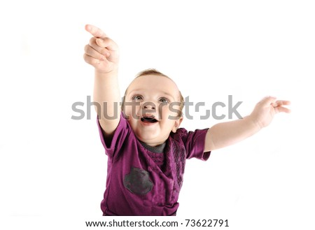 Little cute baby wants to fly into sky, isolated, pointing at something fun - stock photo