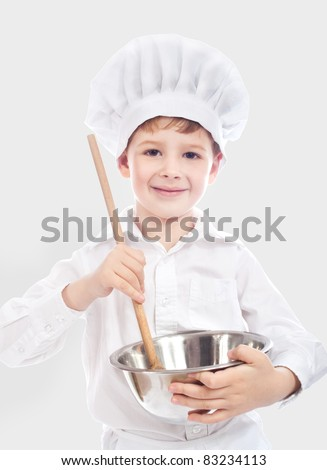 Little cute baker isolated on gray background - stock photo