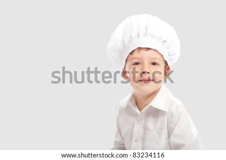 Little cute baker isolated on gray background