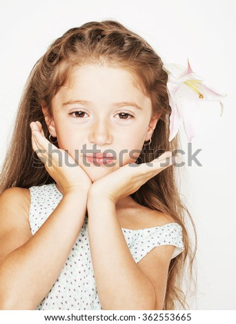 little cute beauty girl isolated on white background holding flower lily in her hair, close up adorable kid - stock photo