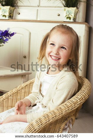 little cute blonde european girl playing at home interior, lifes