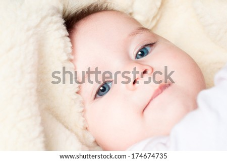 Little cute blue-eyed baby - stock photo