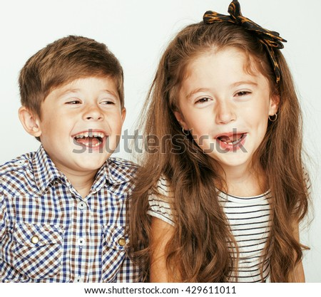 little cute boy and girl hugging playing on white background, happy family - stock photo