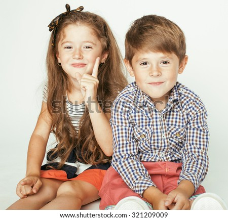 little cute boy and girl hugging playing on white background, happy family close up
