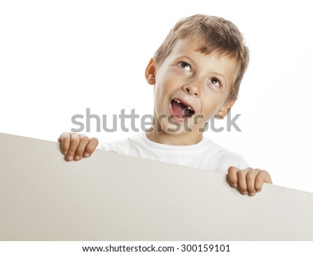 little cute boy holding empty shit to copyspace isolated close up - stock photo