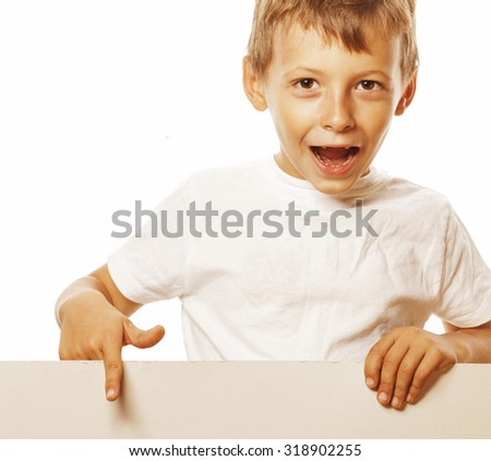 little cute boy holding empty shit to copyspace isolated close up gesturing - stock photo