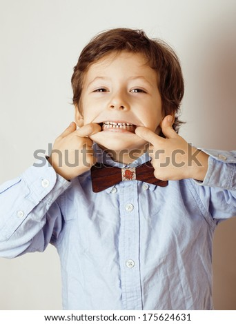little cute boy in bowtie smiling, making funny faces - stock photo