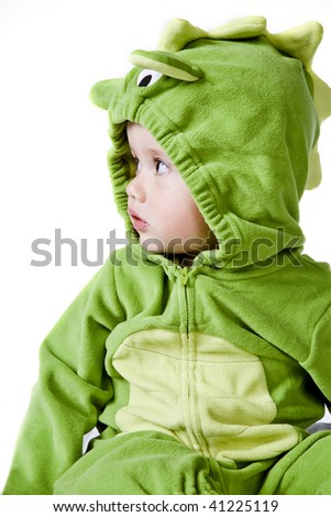 Little cute boy in green costume. - stock photo