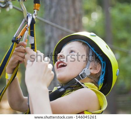 little cute boy in helmet runs track - stock photo
