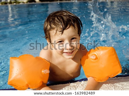 little cute boy in swimming pool - stock photo