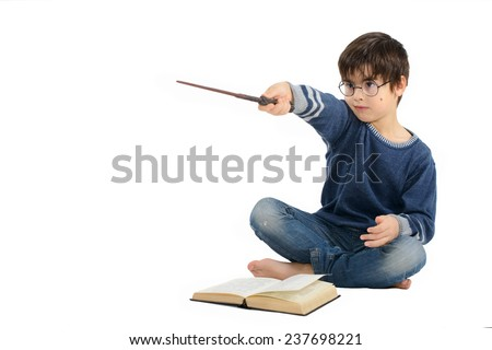 Little cute boy is reading a book and imagining himself a hero - stock photo
