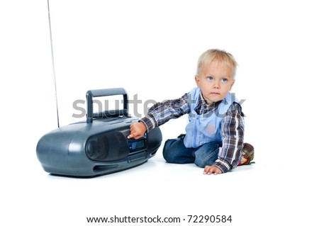 Little cute boy listens to the music.  In the studio - stock photo