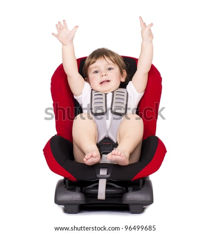 Little cute boy on car safety seat with belt. Isolated on white.