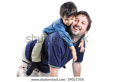 Little cute boy on his father's back playing - stock photo