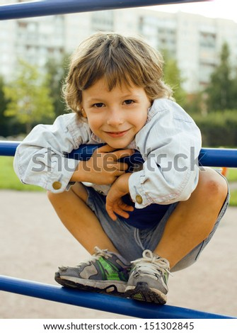 little cute boy on playground outside - stock photo