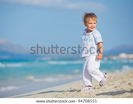 Little cute boy on the beautiful exotic white beach, Mallorca, Spain - stock photo