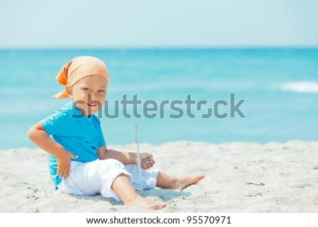 Little cute boy on the exotic white beach, Mallorca, Spain - stock photo