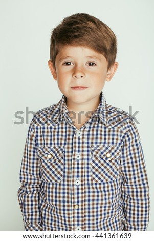 little cute boy on white background gesture smiling close up - stock photo