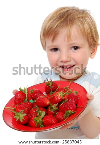 little cute boy show strawberries on a white background