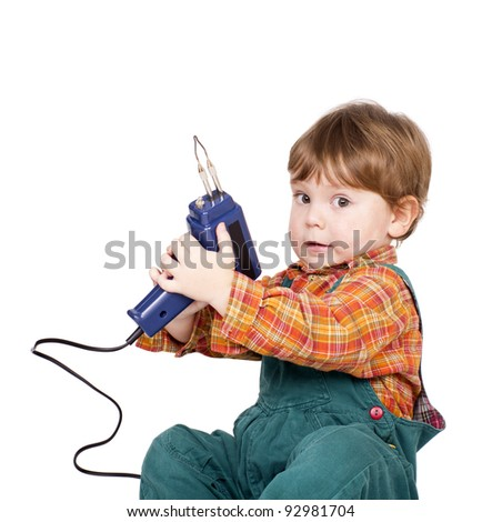 Little cute boy with a hand-tool. Isolated on white. - stock photo
