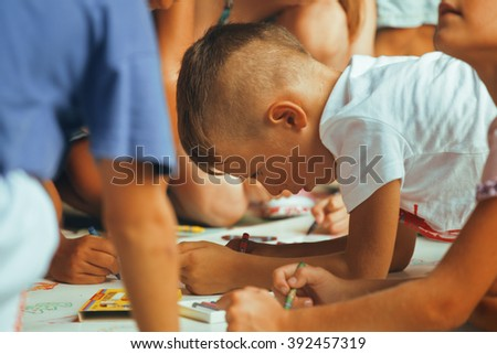 little cute boy with company painting on birthday party - stock photo