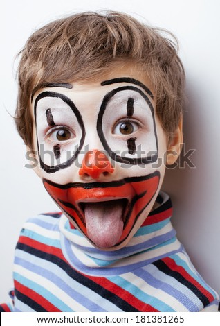 little cute boy with facepaint like clown, pantomimic expressions close up - stock photo
